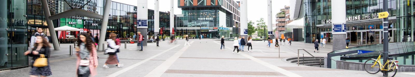 dynamic city and station biew with people passing by