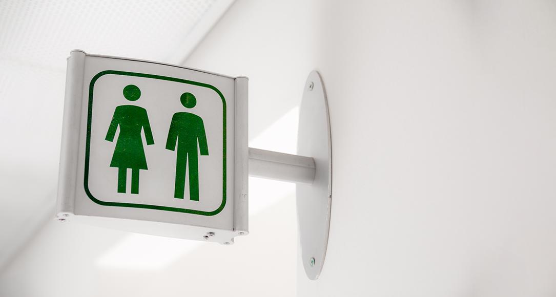 Pictogrammen van man en vrouw bij het toilet.