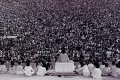 Opening ceremony at Woodstock. Swami Satchidananda giving the opening speech (15 August 1969). Source: Wikimedia/Mark Goff
