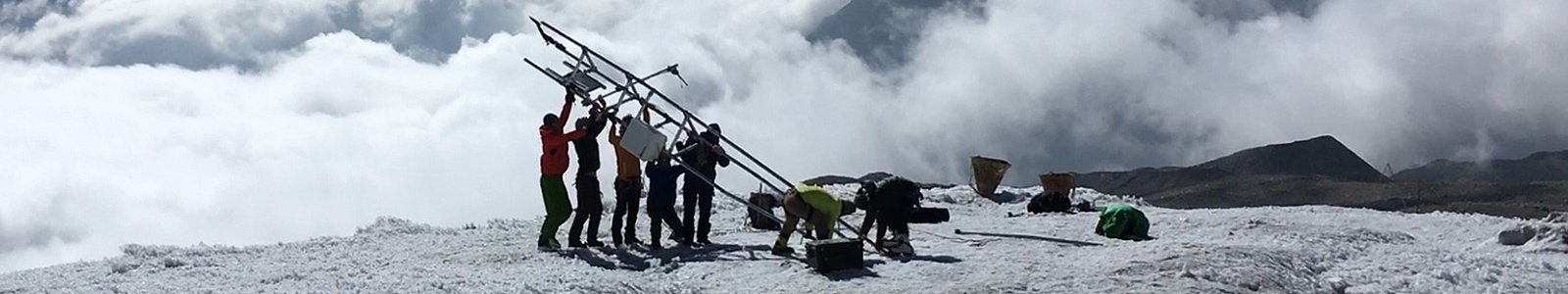 Researchers installing equipment on a snowy Himalaya mountain top