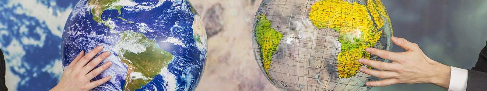Globes in hands