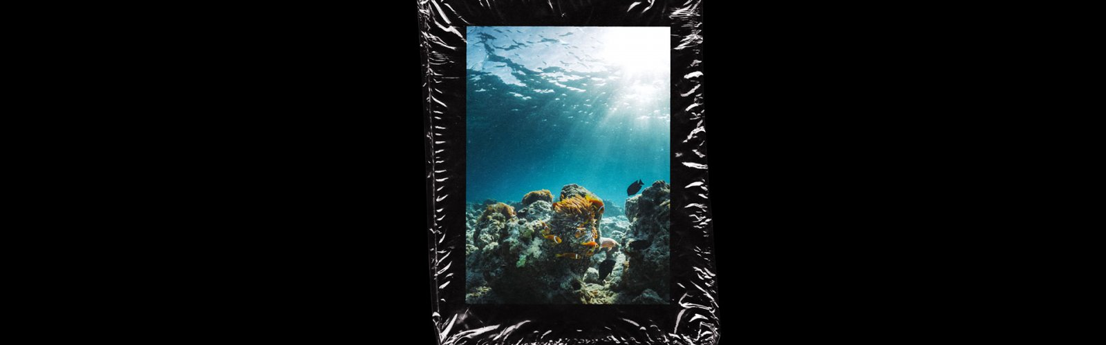 image of an ocean, wrapped in plastic