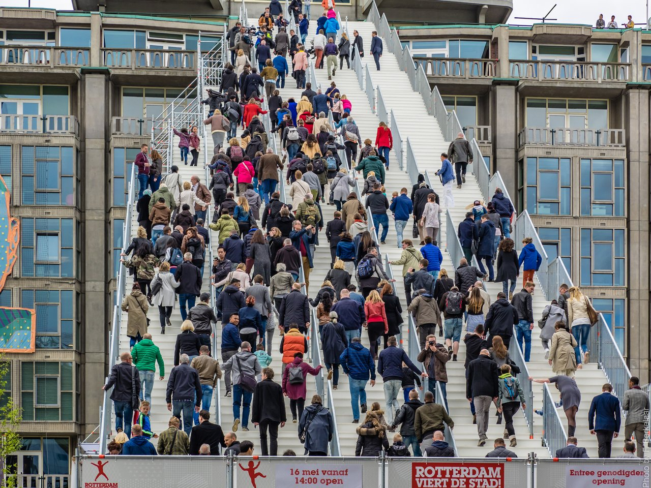 people walking onto huge stairs build in Rotterdam, Netherlands