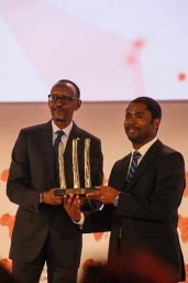 Peter Ngene receives NEF award from Paul Kagame