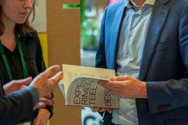 Secretary General Maarten Schurink reading 'Experimental Governance'
