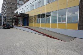 The wheelchair ramp at the main entrance of the Caroline Bleeker building