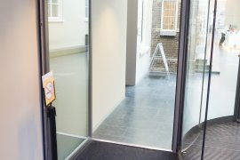 A regular door (access via the front desk) - next to the revolving doors of Drift 27 - University Library City Centre
