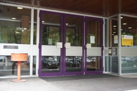 The doors of the main entrance of the Leonard S. Ornstein Laboratory