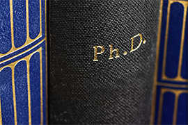 Book cover with 'PhD' on it.