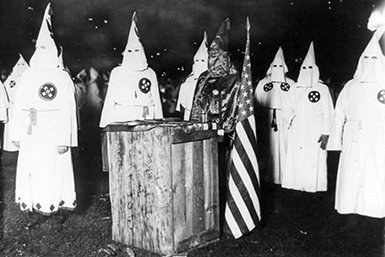Altar with K eagle in black robe at a meeting of nearly 30,000 Ku Klux Klan members from Chicago and northern Illinois. Wikimedia/ Underwood & Underwood
