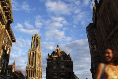 Students walking in Utrecht with the Dom tower in the background