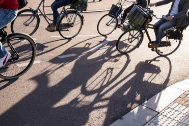 Shadows of bicyclist passing by