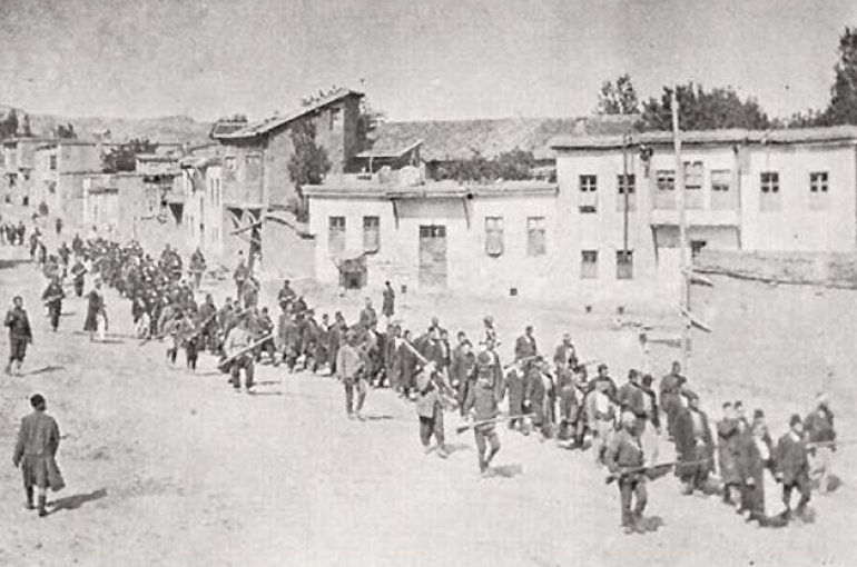 Armenian civilians are marched to a nearby prison in Mezireh by armed Ottoman soldiers. Kharpert, Ottoman Empire, April 1915. - Wikimedia Commons