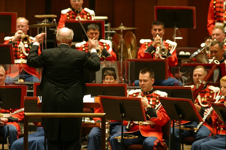 Composer John Williams guest conducted the Marine Band on its 205th birthday. Photo By: Marine Band Public Affairs Office