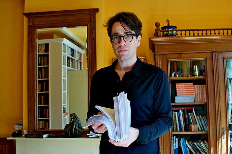 Benjamin Moser with a book manuscript. Source: Wikimedia
