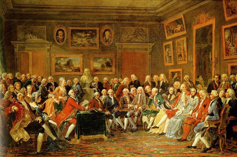 Reading of Voltaire's L'Orphelin de la Chine (a tragedy about Ghengis Khan and his sons, published in 1755), in the salon of Madame Geoffrin (Malmaison, 1812) by Anicet Charles Gabriel Lemonnier. Source: Wikimedia