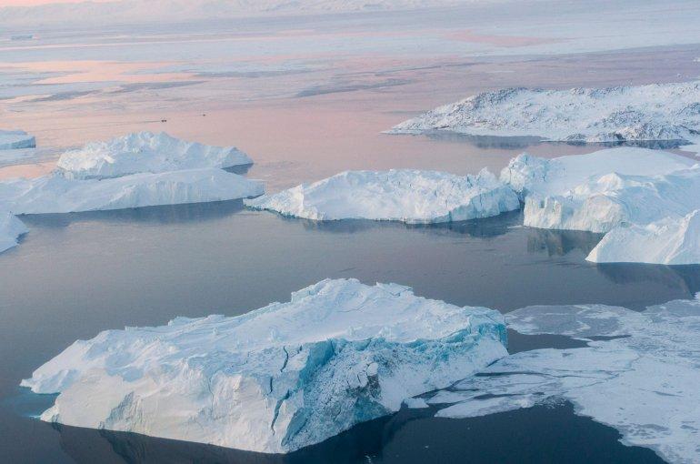 Icebergs near Ililissat, Greenland. Photo by Mark Garten, UN Photo.